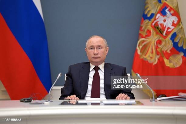 Russian President Vladimir Putin attends a video conference meeting as part of the virtual US-hosted Leaders Summit on Climate, in his residence in...
