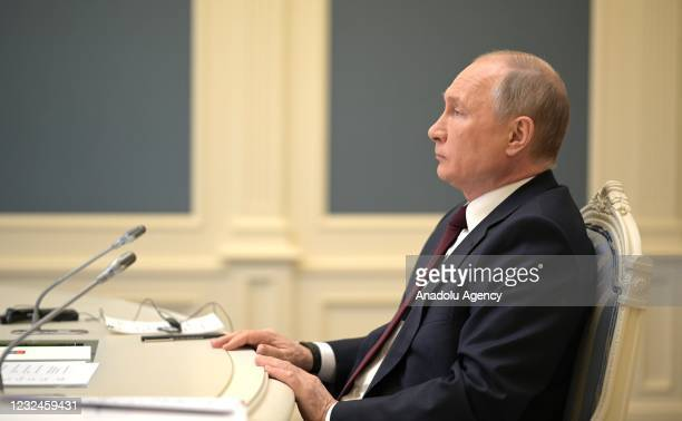 Russian President Vladimir Putin attends a video conference meeting as part of the virtual US-hosted Leaders Summit on Climate in Moscow, Russia on...