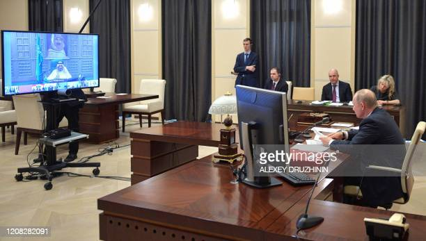 Russian President Vladimir Putin attends a videoconference with G20 leaders to discuss the COVID19 coronavirus outbreak at the NovoOgaryovo residence...