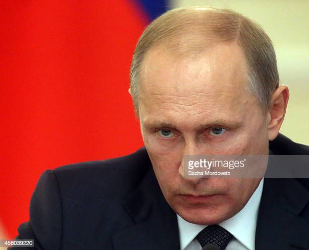 Russian President Vladimir Putin attends a weekly meeting with ministers of the government at the Novo Ogaryovo state residence October 29, 2014 in...