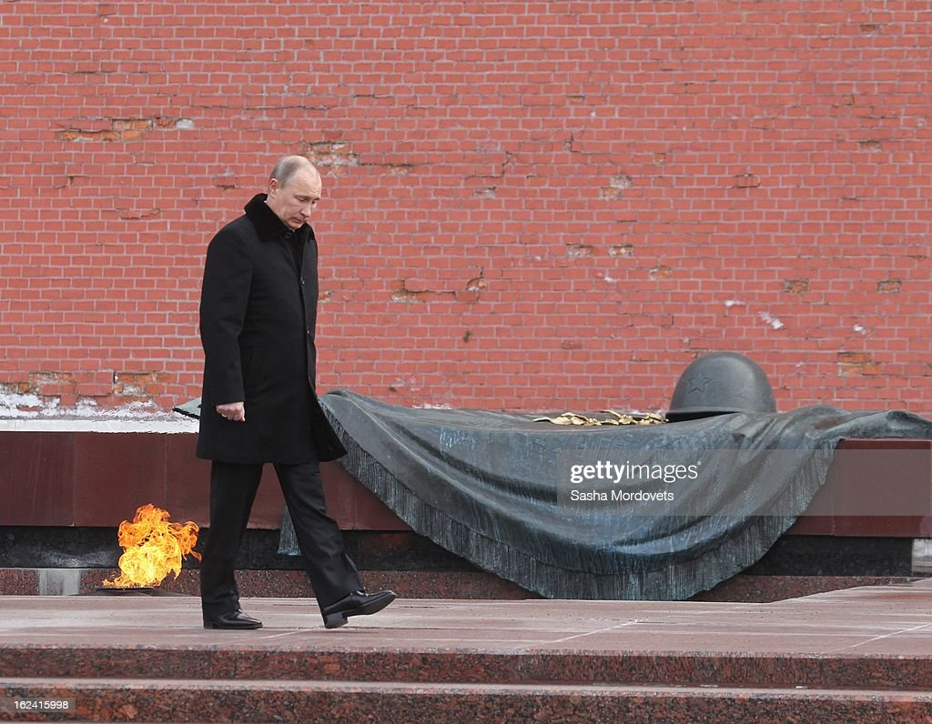 Russian President Vladimir Putin attends a wreath laying ceremony at the tomb of the Unknown Soldier, near Kremlin wall on February 23, 2013 in Moscow, Russia. Russians are commemorating the Defender of the Fatherland Day - formerly known as Soviet Army Day - which marks the date in 1918 of the first mass draft into the Red Army during the Russian Civil War.