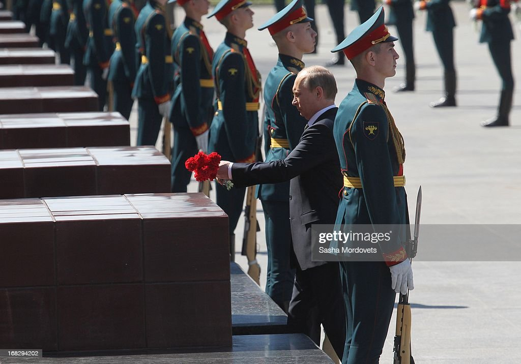 Russian President Vladimir Putin (C) attends a wreath laying ceremony at the Tomb of the Unknown Soldier near the Kremlin on May, 8 2013 in Moscow, Russia. Russia will tomorrow hold traditional parades to mark the 68th anniversary of the defeat of Nazi Germany in World War II.