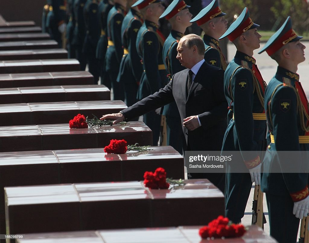 Russian President Vladimir Putin (C) attends a wreath laying ceremony at the Tomb of the Unknown Soldier near the Kremlin on May, 8 2013 in Moscow, Russia. Russia will hold victory parades tomorrow to mark the 68th anniversary of the defeat of Nazi Germany in World War II.