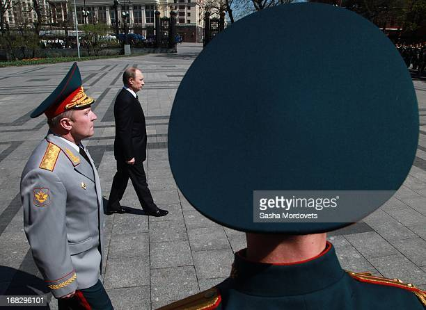 Russian President Vladimir Putin attends a wreath laying ceremony at the Tomb of the Unknown Soldier near the Kremlin on May, 8 2013 in Moscow,...