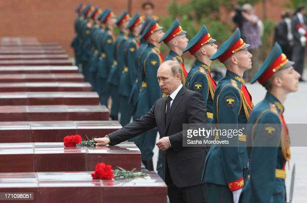 Russian President Vladimir Putin attends a wreath laying ceremony at the Tomb of the Unknown Soldier in Alexander Garden near the Kremlin on June...