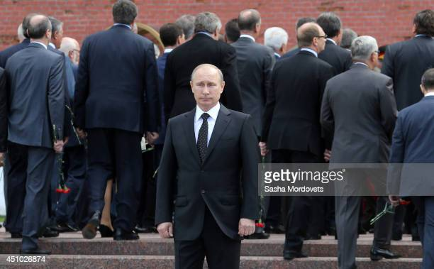 Russian President Vladimir Putin attends a wreath laying ceremony at the Tomb of Unknown Soldier ouside Moscow's Kremlin Wall to mark 73rd...