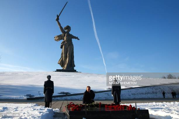Russian President Vladimir Putin attends a wreath laying ceremony at the eternal flame of the Mamayev Kurgan memorial complex in the city of...