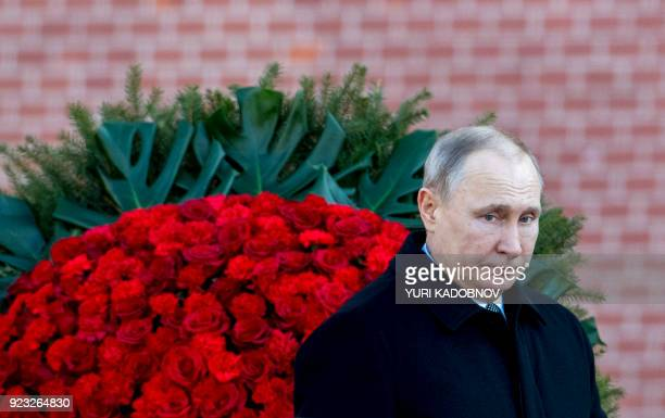 Russian President Vladimir Putin attends a wreath laying ceremony at the Tomb of the Unknown Soldier near the Kremlin wall to mark Defender of the...