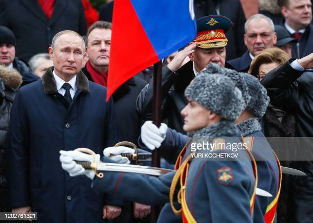 Russian President Vladimir Putin attends a wreathlaying ceremony at the Tomb of the Unknown Soldier by the Kremlin wall to mark the Defender of the...