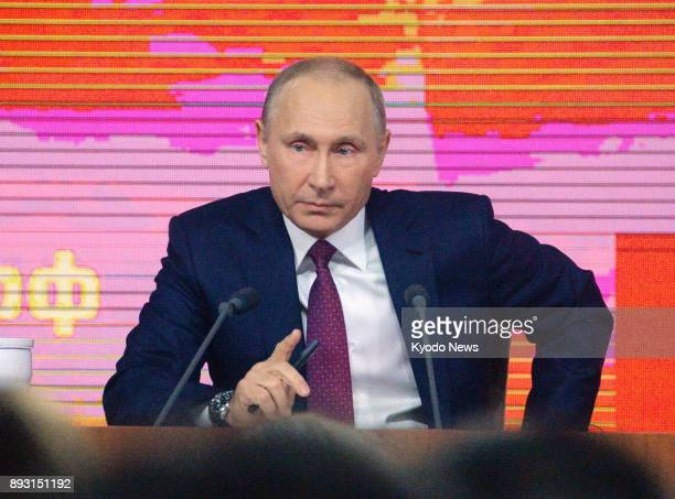 Russian President Vladimir Putin attends an annual endofyear press conference in Moscow on Dec 14 2017 Putin said US Secretary of State Rex...