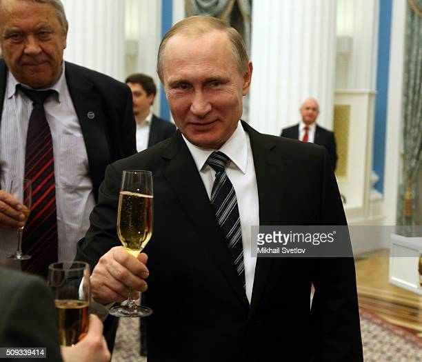 Russian President Vladimir Putin attends an award ceremony at the Kremlin on February 10 2016 in Moscow Russia Putin awarded three scientists during...
