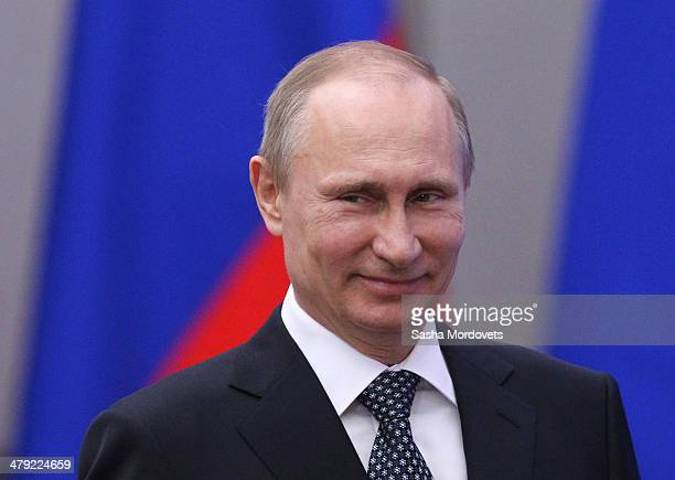 Russian President Vladimir Putin attends an awarding ceremony for Russian team members who won medals at the Winter Paraltmpic games on March 17,...
