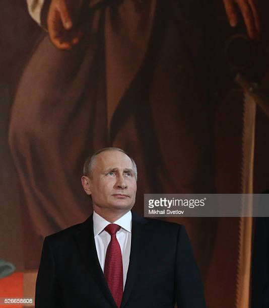 Russian President Vladimir Putin attends an Orthodox Easter mass at the Christ The Saviour Catherdal in Moscow Russia May 2016 Russian President...