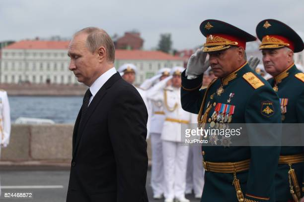 Russian President Vladimir Putin attends parade on Russia's Navy Day the Main Naval Parade to mark Russian Navy Day in St Petersburg Russia on 30...