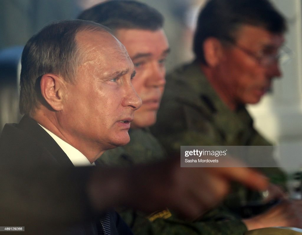Russian President Vladimir Putin (L) attends Russias large-scale Center-2015 military exercises at Donguzsky Range September 19, 2015 in Orenburg, Russia, The exercises, aim to contain the outbreak of an armed conflict in Central Asia. Putin said this week that it's impossible to defeat Islamic State group without support of the government of Syria and that Moscow has provided military assistance to President Bashar al-Assad's regime and will continue to do so.