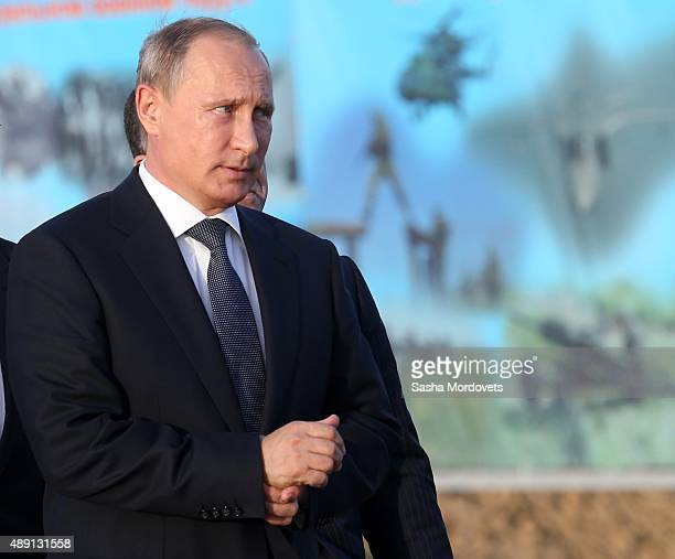 Russian President Vladimir Putin attends Russias large-scale Center-2015 military exercises at Donguzsky Range September 19, 2015 in Orenburg,...