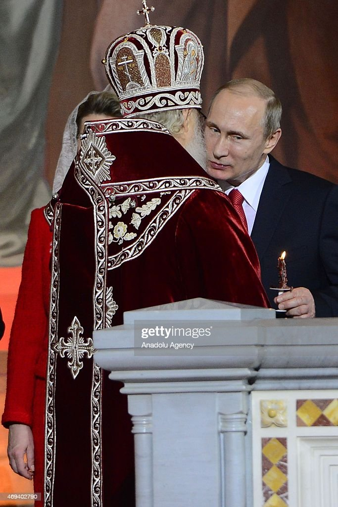 Russian President Vladimir Putin attends the Easter service led by Patriarch Kirill of Russia (L) in Christ the Savior Cathedral in Moscow, Russia on April 12, 2015. Orthodox Christian believers mark the Holy Week of Easter in celebration of the crucifixion and resurrection of Jesus Christ.