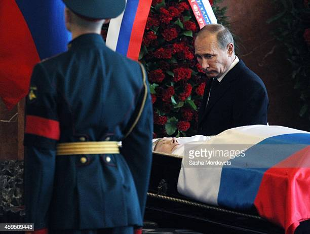 Russian President Vladimir Putin attends the funeral ceremony for Mikhail Kalashnikov at the Federal Military Memorial Cemetery December 27 2013 in...