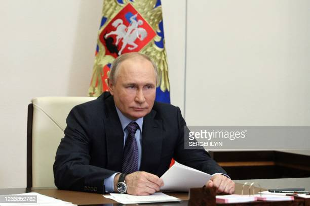 Russian President Vladimir Putin attends the launching ceremony of the Gazprom's Amur Gas Processing Plant, via a video conference, at the...
