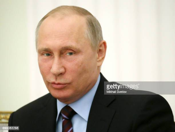 Russian President Vladimir Putin attends the meeting with Deputy Crown Prince and Defence Minister of Saudi Arabia Mohammad bin Salman Al Saud at the...