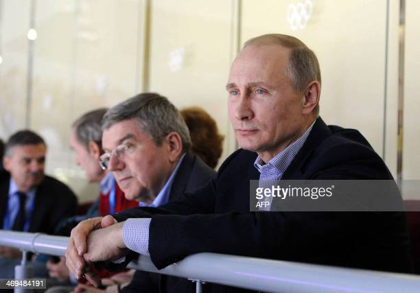 Russian President Vladimir Putin attends the Russia vs US hockey match held as part of the preliminary round of the XXII Olympic Winter Games in...