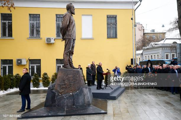Russian President Vladimir Putin attends the unveiling ceremony of a statue of Russian writer and dissident Alexander Solzhenitsyn in Moscow on...