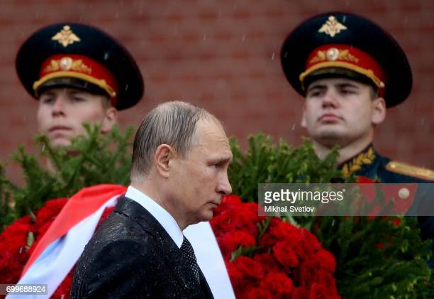 Russian President Vladimir Putin attends the wreath laying ceremony at the Unknown Soldier's Tomb at Alexander Garden outside of the Kremlin on June...