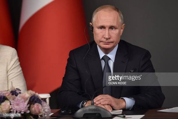 Russian President Vladimir Putin attends to a conference during a summit called to attempt to find a lasting political solution to the civil war in...