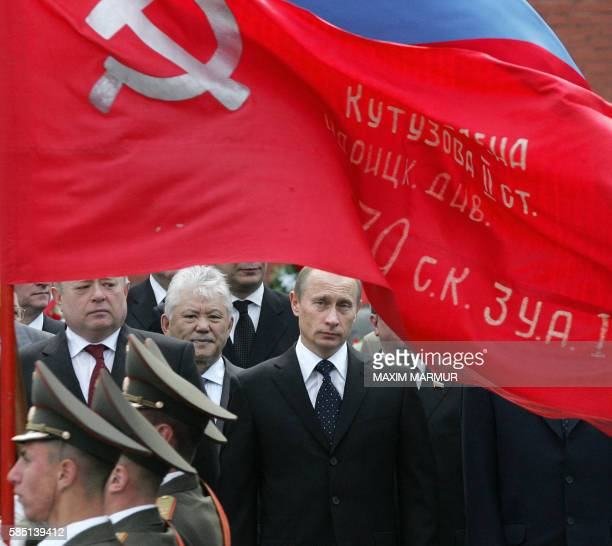 Russian President Vladimir Putin attends wreath-laying ceremony at the Tomb of the Unknown Soldier near the Kremlin wall in Moscow 08 May 2006 during...
