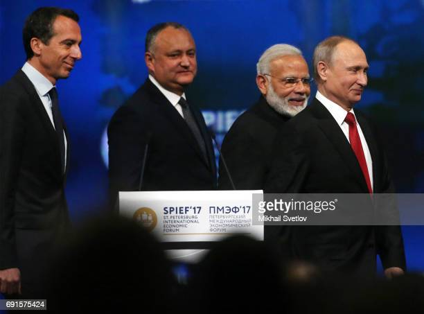 Russian President Vladimir Putin , Austrian Chancellor Christian Kern , Indian Prime Minister Narendra Modi and Moldovan President Igor Dodon arrive...