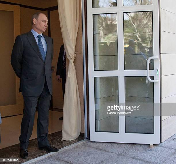 Russian President Vladimir Putin awaits the arrival of Turkish President Recep Tayyip Erdogan at his newly built Bocharov Ruchey state residence on...