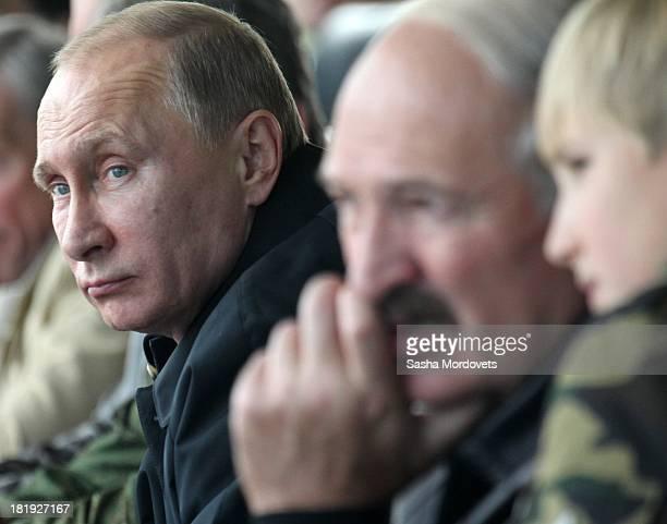 Russian President Vladimir Putin , Belarussian President Alexander Lukashenko and his son Nikolai watch joint Russian-Belarussian military exercises...