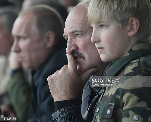 Russian President Vladimir Putin Belarussian President Alexander Lukashenko and his son Nikolai watch joint RussianBelarussian military exercises at...
