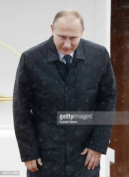 Russian President Vladimir Putin bows before getting on a Tokyobound plane at Yamaguchi Ube airport in western Japan on Dec 16 2016 Putin and...