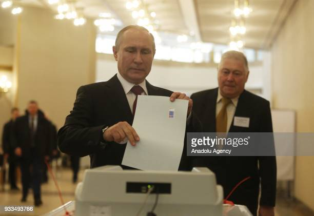 Russian President Vladimir Putin casts his ballot at a polling station during the 2018 Russian presidential election in Moscow Russia on March 18 2018