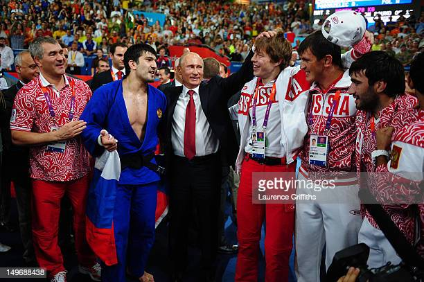 Russian President Vladimir Putin celebrates Tagir Khaibulaev of Russia's gold medal in the Men's 100 kg Judo on Day 6 of the London 2012 Olympic...