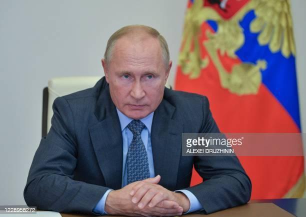 Russian President Vladimir Putin chairs a meeting on fire emergency response in Ryazan Region, via teleconference call, at Novo-Ogaryovo residence,...