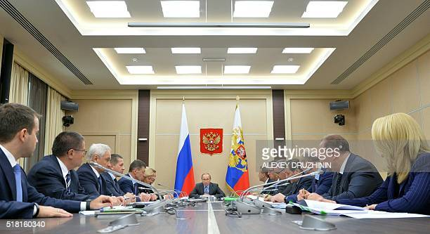 Russian President Vladimir Putin chairs a meeting with members of the government at the NovoOgaryovo state residence outside Moscow on March 30 2016...