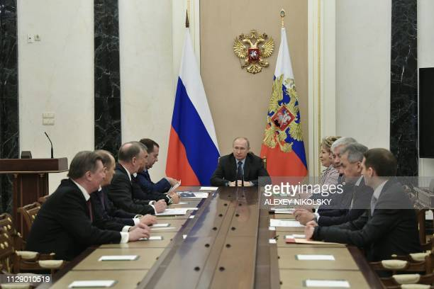 Russian President Vladimir Putin chairs a meeting with permanent members of the Security Council in Moscow on March 7 2019