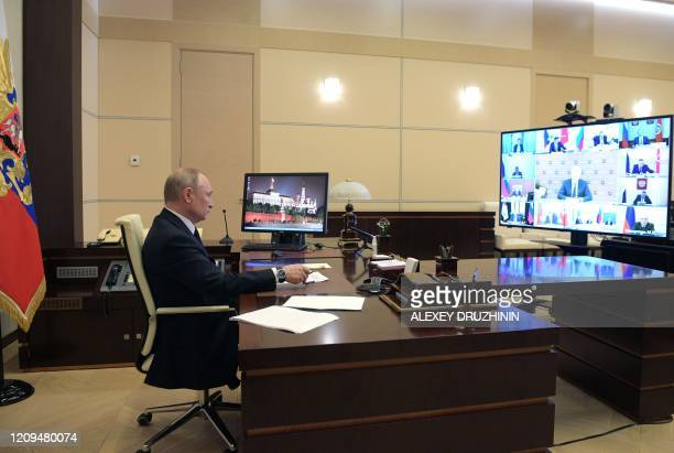 Russian President Vladimir Putin chairs a meeting with senior government officials and regional governors on the situation with the spread of the...