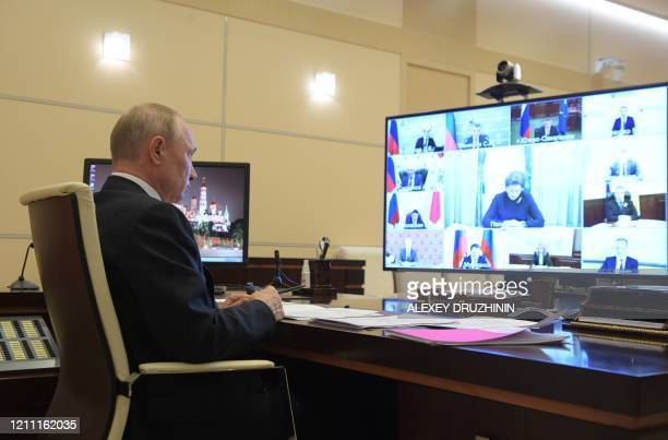 Russian President Vladimir Putin chairs a video conference meeting with heads of Russia's regions over the COVID-19 coronavirus situation, at the...