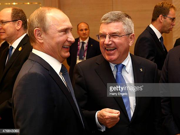 Russian President Vladimir Putin chats with IOC President Thomas Bach during the Opening Ceremony for the Baku 2015 European Games at the Olympic...