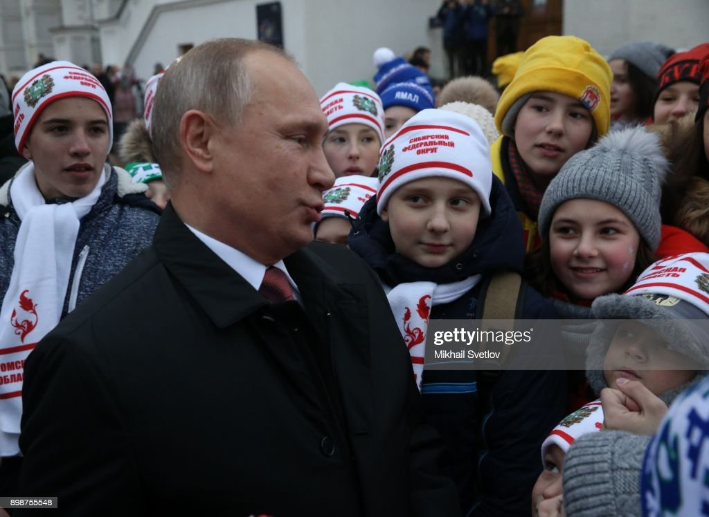 Russian President Vladimir Putin chats with kids at the on December 26, 2017 in the Cathedral Square of Moscow's Kremlin, Russia. Vladimir Putin met children from some regions after they visited the New Year show at the State Kremlin Palace. Photo by Mikhail Svetlov/Getty Images)