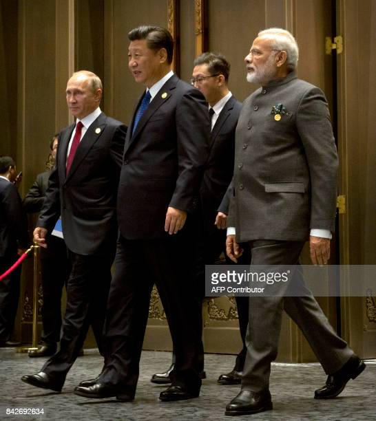 Russian President Vladimir Putin Chinese President Xi Jinping and Indian Prime Minister Narendra Modi arrive for the Dialogue of Emerging Market and...