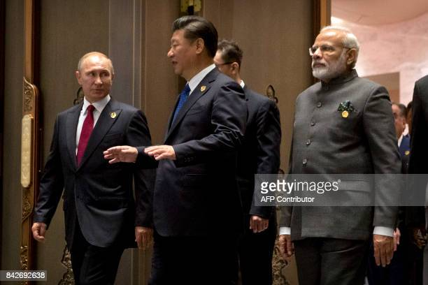 Russian President Vladimir Putin, Chinese President Xi Jinping and Indian Prime Minister Narendra Modi arrive for the Dialogue of Emerging Market and...