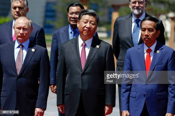 Russian President Vladimir Putin Chinese President Xi Jinping Indonesia's President Joko Widodo and other delegation heads pose for a group photo as...