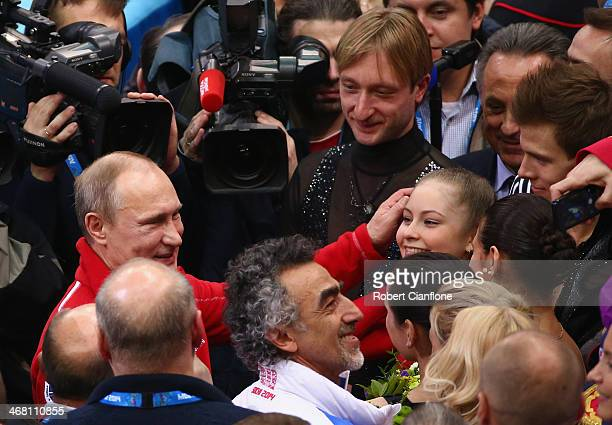 Russian President Vladimir Putin congratulates Yulia Lipnitskaya of Russia after the Team Figure Skating event on day 2 of the Sochi 2014 Winter...