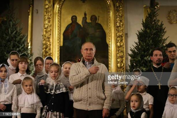 Russian President Vladimir Putin crosses himself during Mass marking the Russian Orthodox Christmas at the Transfiguraton Cathedral January 7 2020 in...