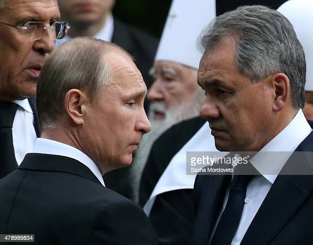 Russian President Vladimir Putin Defence Minister Sergei Shoigu and Foreign Minister Sergei Lavrov attends the funeral for former Prime Minister...
