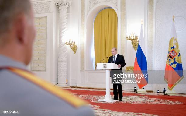 Russian President Vladimir Putin delivers a speech at a ceremony to present state awards to Russian military personnel who fought in Syria at the...